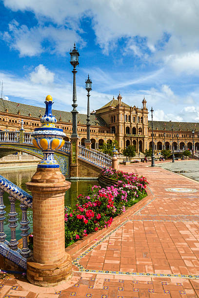 Plaza de Espana - Sevilla Spain Courtyard square of Paza de Espana in Sevilla Spain. Deep blue sky with fluffy white clouds. seville stock pictures, royalty-free photos & images