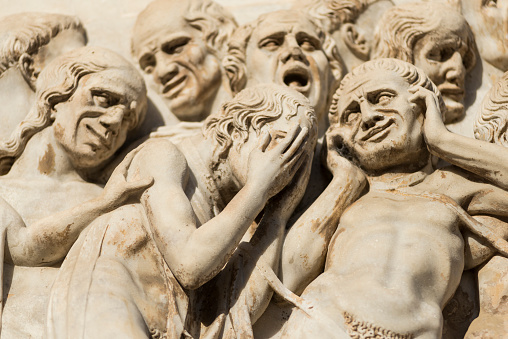 Pleading human figures from Last Judgment on Orvieto cathedral