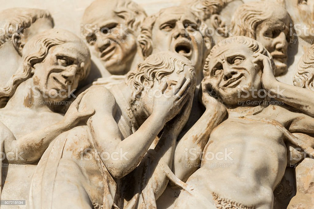 Pleading human figures from Last Judgment on Orvieto cathedral stock photo