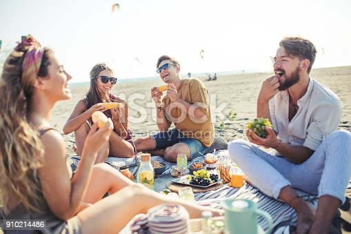 Friends go partying on the beach