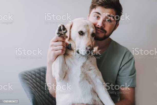 Pleasant bearded man sitting with his dog picture id1095983622?b=1&k=6&m=1095983622&s=612x612&h=1uqn21nm0ja6hzbnktj2eekw0l3fjfgrbg6kjynnp8i=