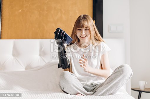 istock pleasant girl having fun with smartphone 1176972101