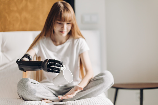 istock pleasant girl testing her cyber arm 1176972945