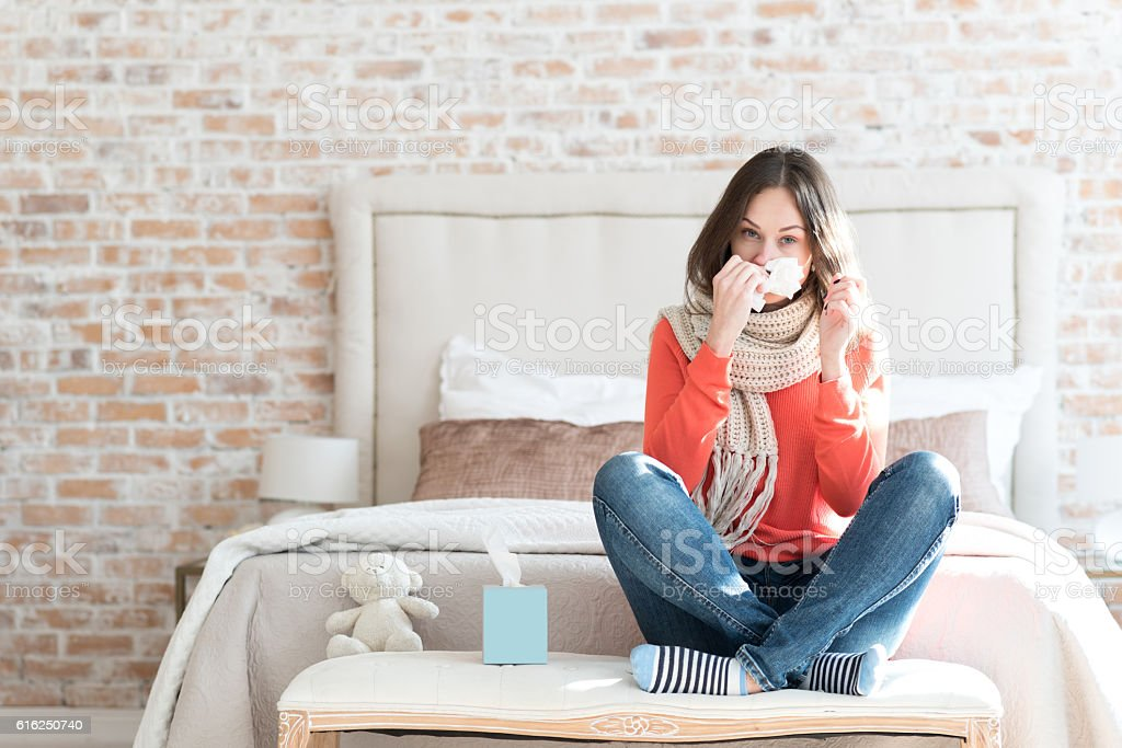 Pleasant gloomy woman suffering from cold stock photo