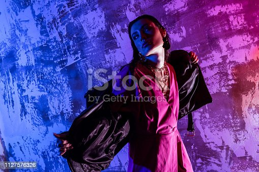 istock Pleasant good looking woman holding her jacket 1127576326