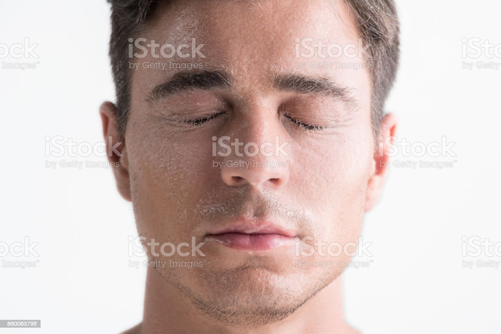 Pleasant guy is feeling freshness stock photo