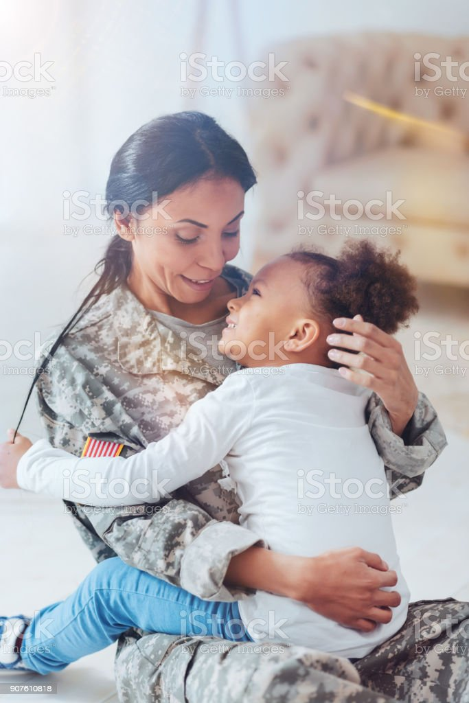 Pleasant happy mother and daughter spending time together stock photo