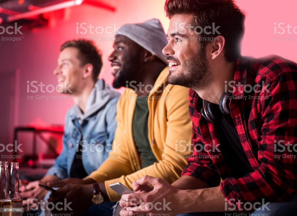 Pleasant males are having fun together stock photo