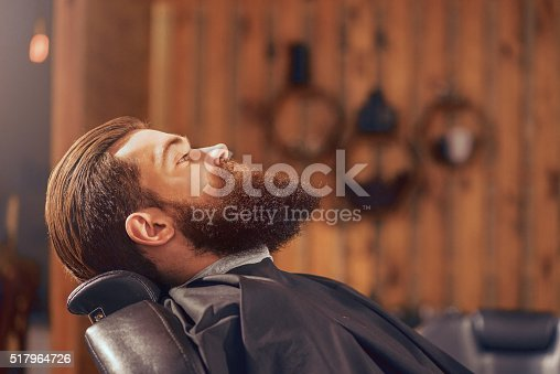 istock Pleasant man sitting in the barbershop 517964726