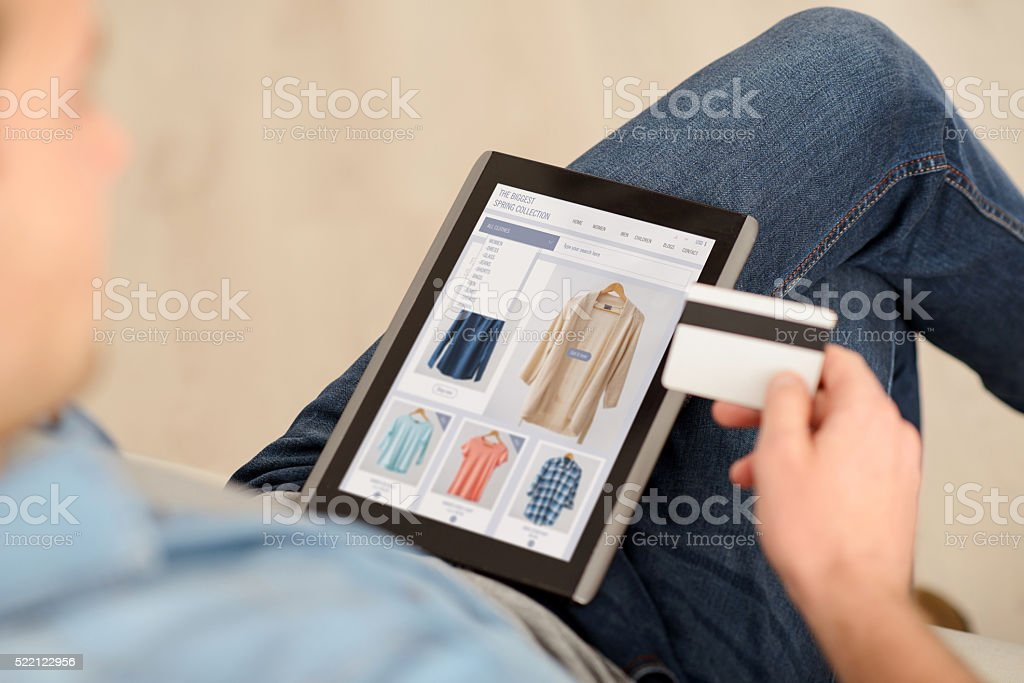 Pleasant man using tablet stock photo