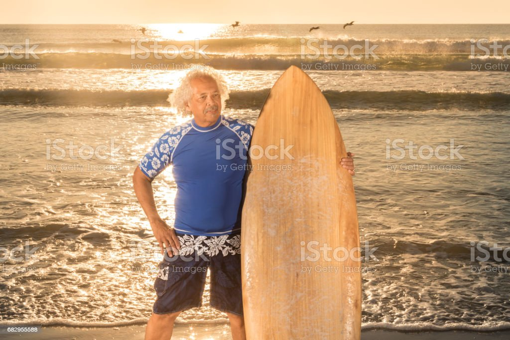 Pleasant mature surfer at sunrise royalty-free stock photo