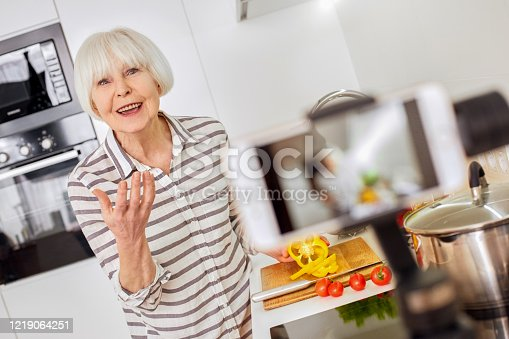 1179265329 istock photo Pleasant modern stylish aged european woman groomed leads records shows online marathon food meal program. Tells people easy instruction recipes of healthy ingredients. Technology device camera sale 1219064251