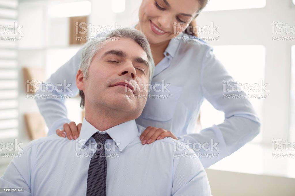 Pleasant nice man closing his eyes stock photo