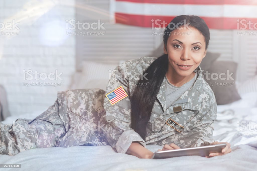 Pleasant nice woman looking at you stock photo