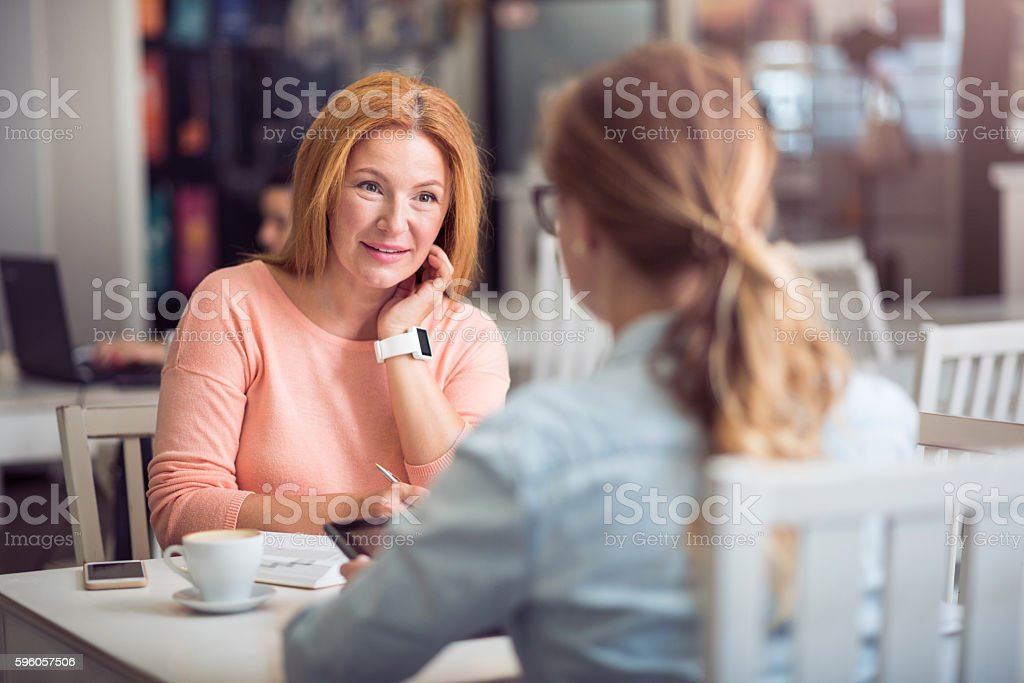 Pleasant senior woman conducting an interview royalty-free stock photo