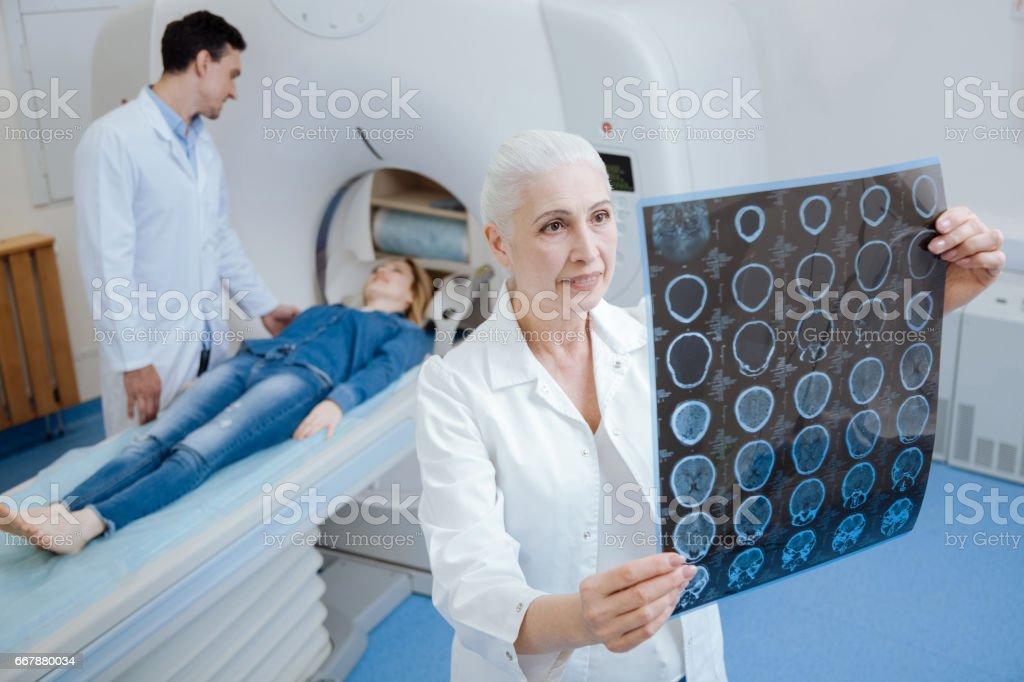 Pleasant senior woman noticing the improvement stock photo