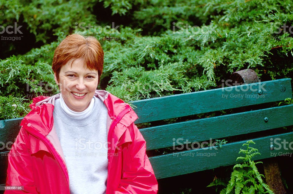 Pleasant Smiling Lady in Red royalty-free stock photo