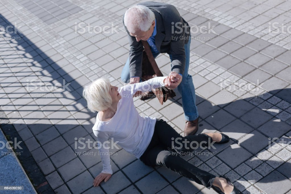 Pleasant woman tumbling over outdoors stock photo