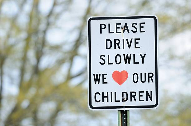 Please drive slowly we lover our children sign stock photo