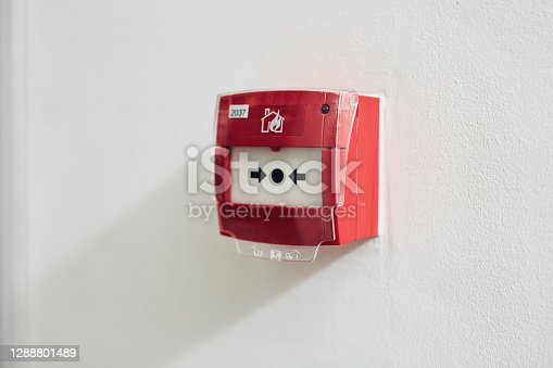 Shot of a fire alarm switch mounted on a wall
