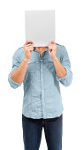 A male holding up a blank placard in front of his face - Copy space - Conceptual