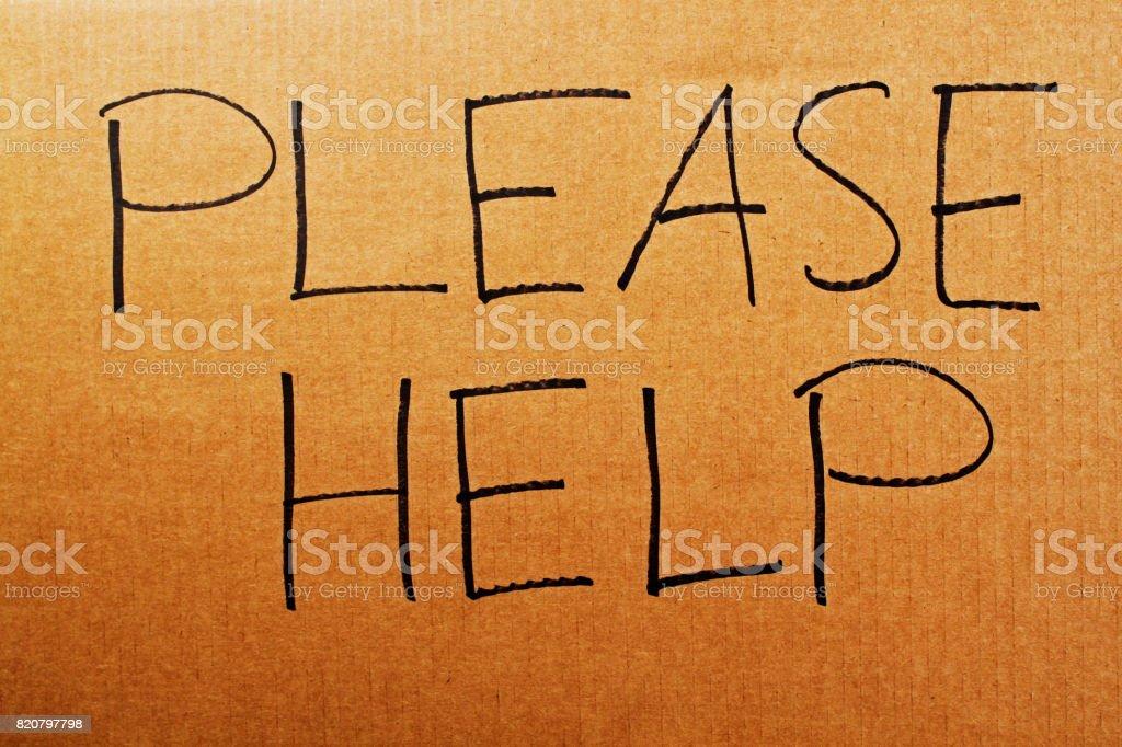 Please Help Cardboard Sign stock photo