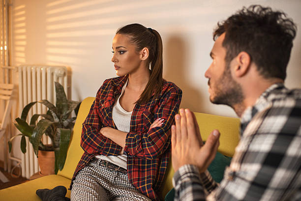 Please honey forgive me! Angry woman doesn't pay attention to her boyfriend who is asking for her forgiveness. pleading stock pictures, royalty-free photos & images