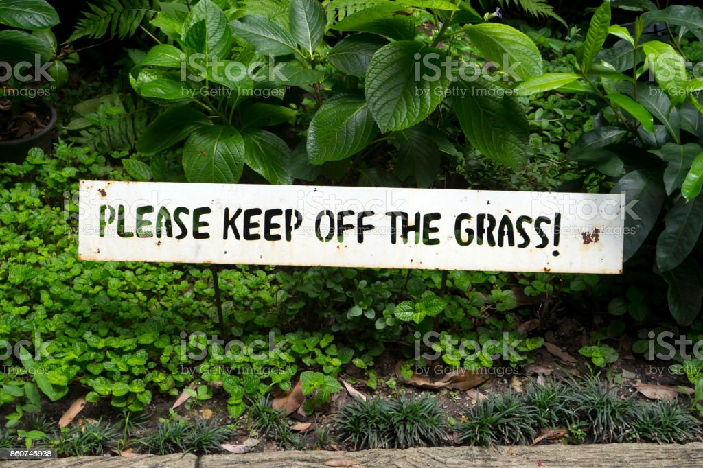 please keep of the grass stock photo