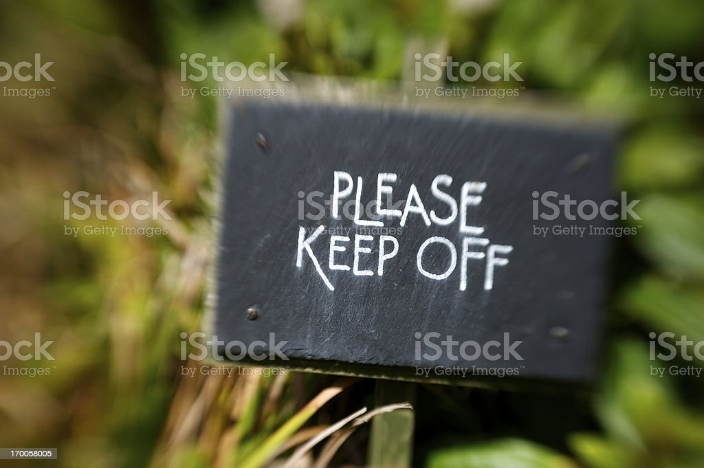 Please Keep Off Sign Tilt Shift Focus stock photo