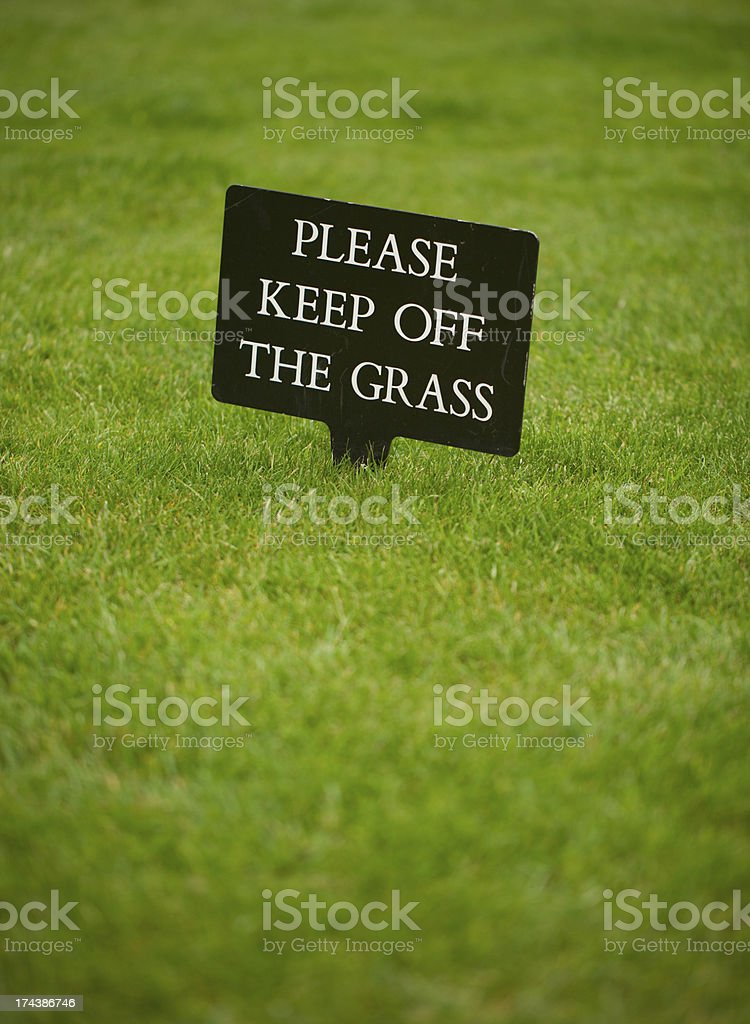 Please keep off the grass sign stock photo