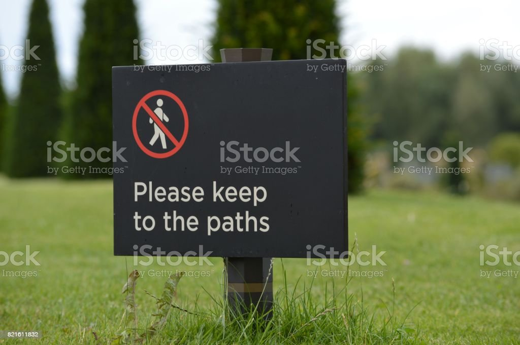 Please keep to the paths sign. stock photo