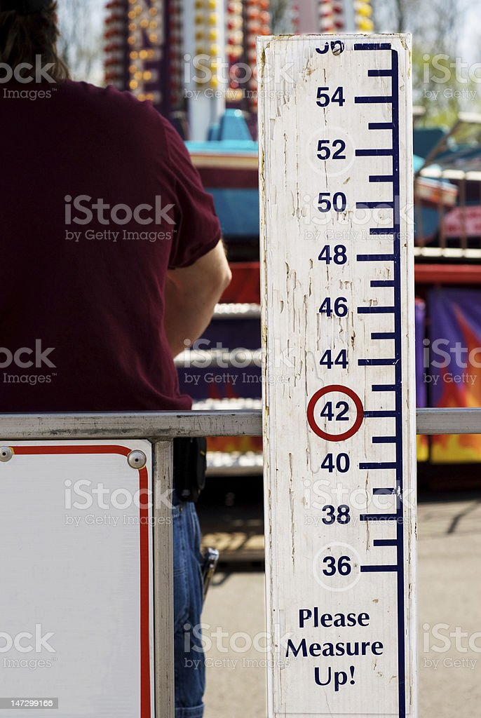 Please Measure Up Sign at Carnival stock photo