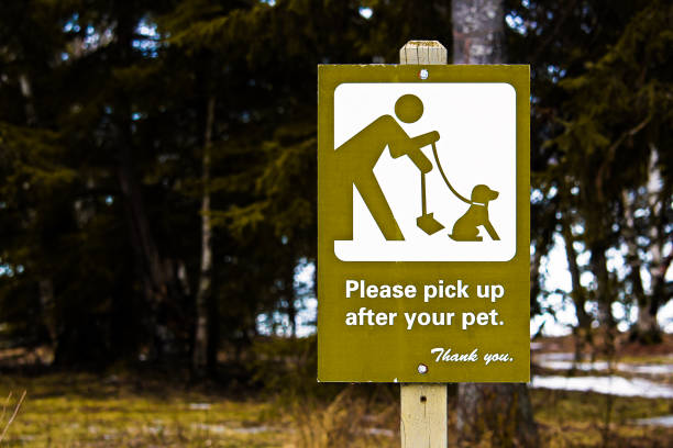 Please Pick Up After Your Pet sign Please Pick Up After Your Pet sign. poop stock pictures, royalty-free photos & images