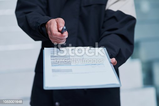 1053001624istockphoto Please sign here to receive your parcel 1053001648