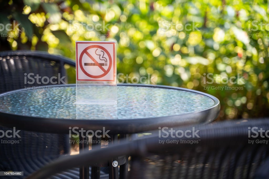 please Stop smoking concept No smoking sign in the coffee shop go...