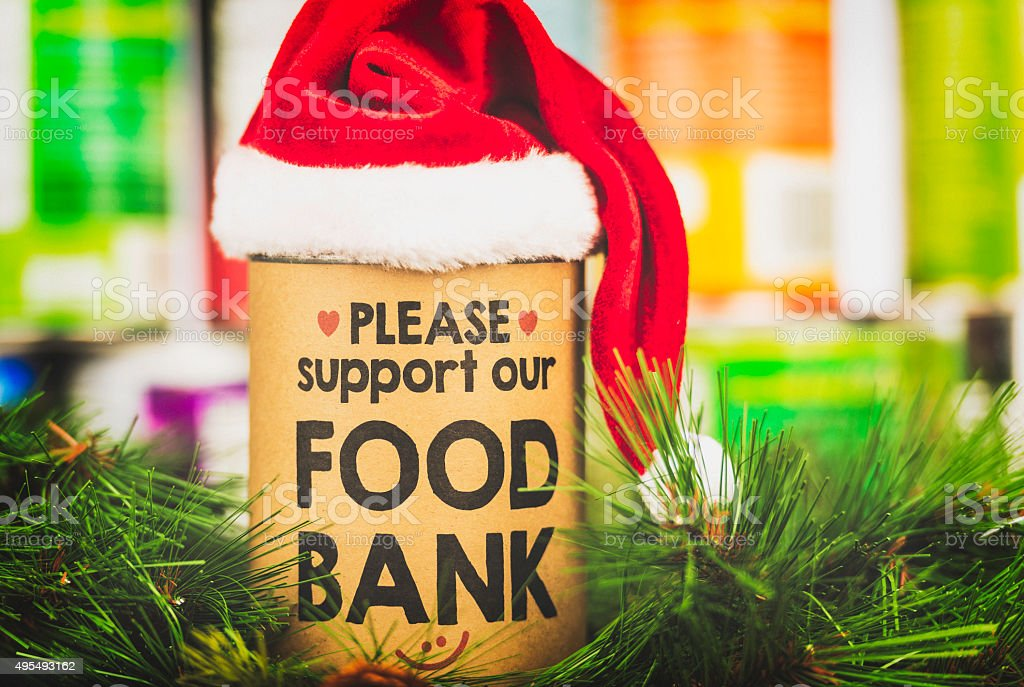 Please support our food bank. Holiday canned food drive stock photo
