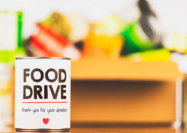 Please support our food drive. Canned food drive Please support our food drive. Canned food drive food drive stock pictures, royalty-free photos & images