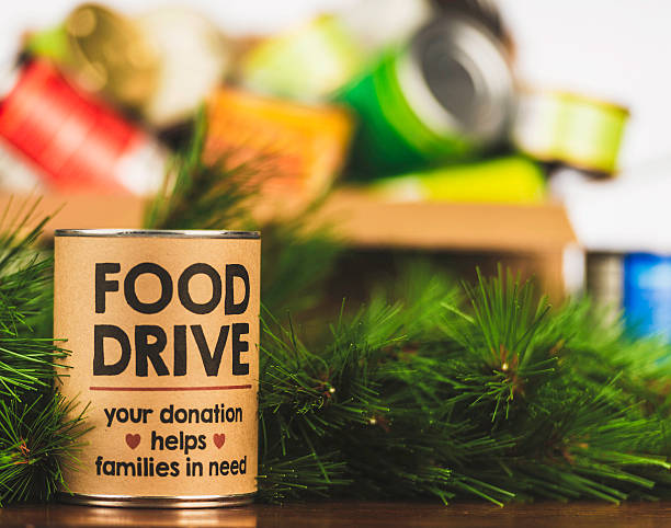 Please support our food drive. Holiday canned food drive Please support our food drive. Holiday canned food drive food drive stock pictures, royalty-free photos & images