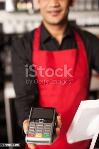 178974134istockphoto Please swipe your card to process payment 178846085