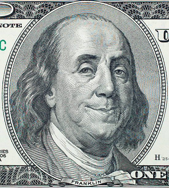 Pleased Benjamin Franklin portrait Pleased President Benjamin Franklin portrait on 100 US dollar bill benjamin franklin stock pictures, royalty-free photos & images