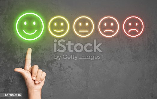 693589426 istock photo Pleased client evaluating service with smiling icon 1187580410
