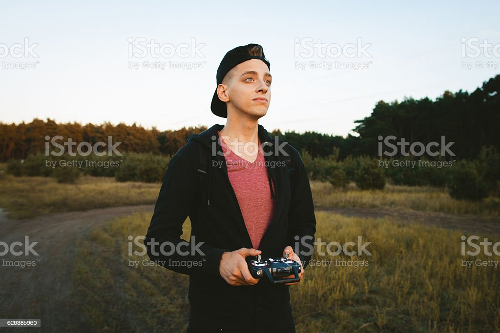 Pleased man looking for his new drone run stock photo