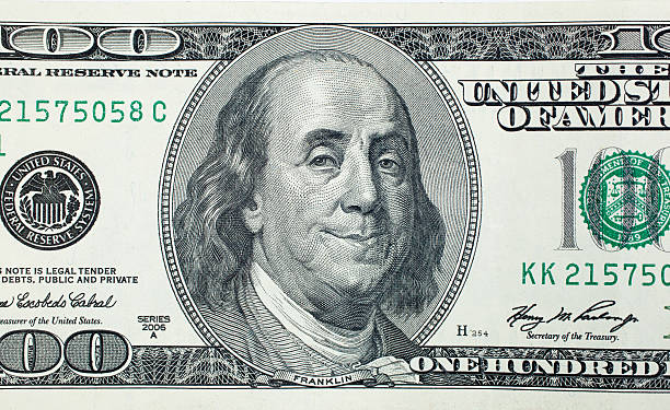 Pleased President Benjamin Franklin Pleased President Benjamin Franklin on 100 US dollar bill benjamin franklin stock pictures, royalty-free photos & images