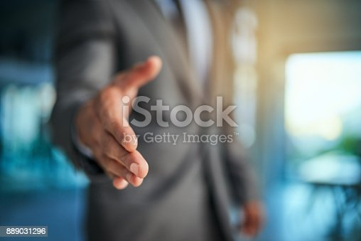 Cropped shot of a businessman extending his arm for a handshake