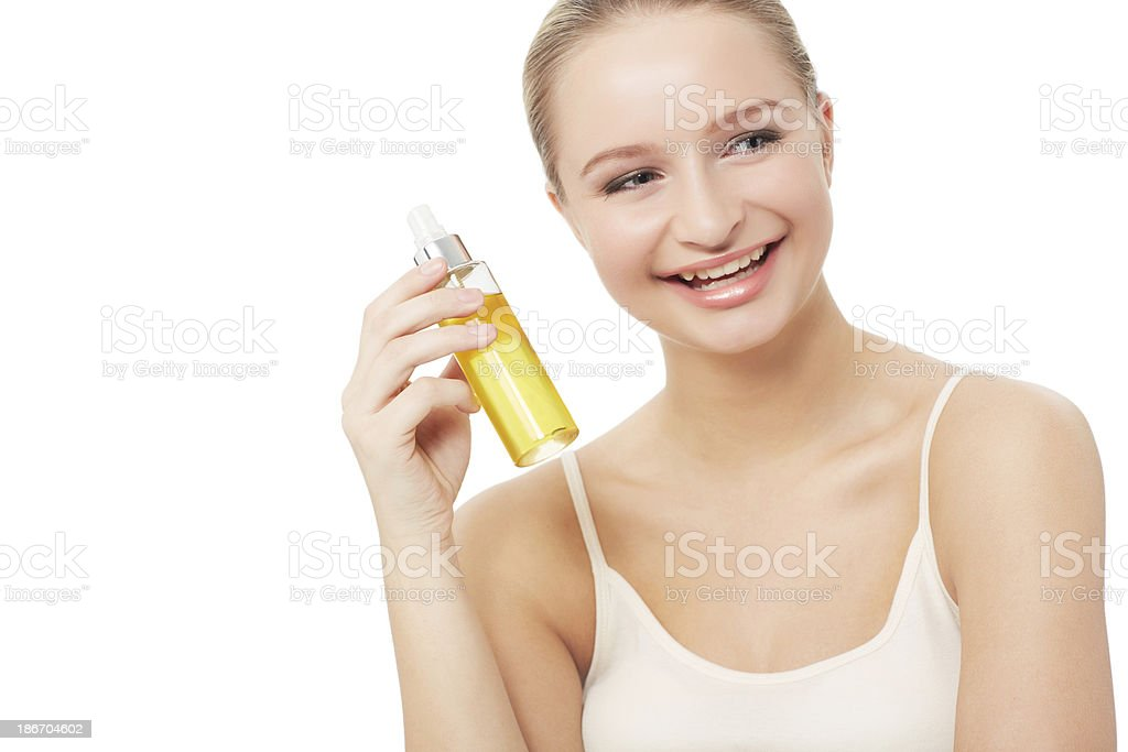 Pleased with her beauty products royalty-free stock photo