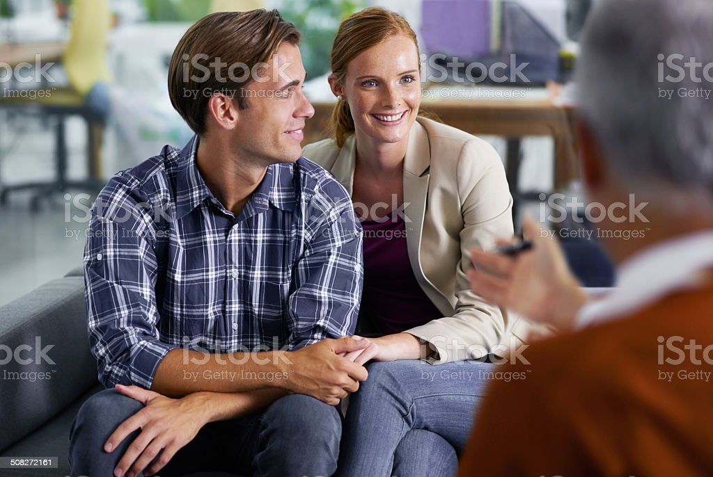 Pleased with their financial assessment stock photo
