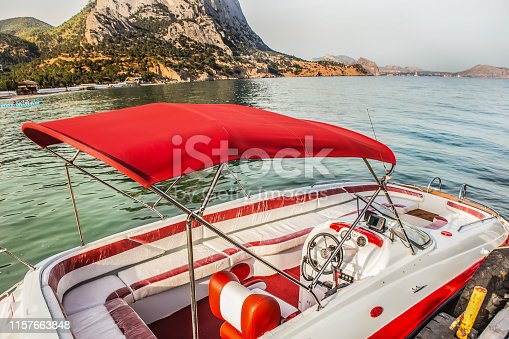 Pleasure boat at the pier in the lagoon at sea