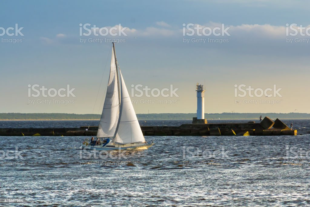 Pleasure boat is sailing from harbor to sea stock photo