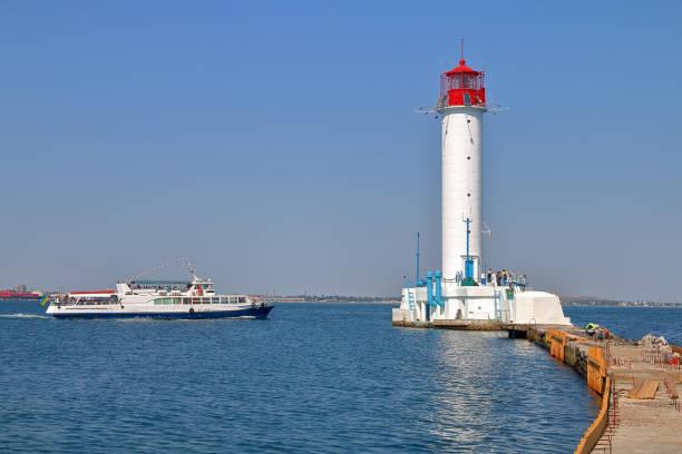 Pleasure boat sailing near the Odessa lighthouse.