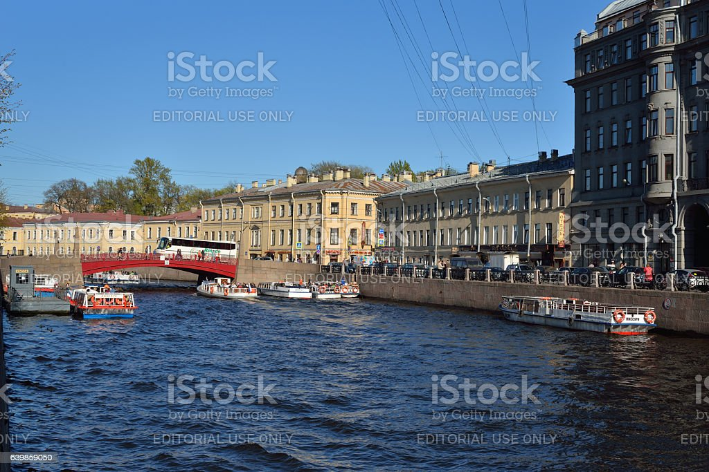 pleasure boat with tourists on the river Moika stock photo